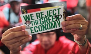 """Protester with sign rejecting the """"greed economy"""""""