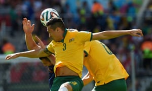 Australia's defender Jason Davidson heads the ball as the game gets under way.