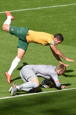 Netherlands' goalkeeper Jasper Cillessen (bottom) vies with Australia's forward Mathew Leckie.