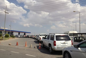 Motorists line up outside a gas station in Irbil in northern Iraq on 18 June 2014.