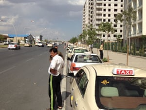 Motorists line a street waiting for gas in Irbil in northern Iraq on 18 June 2014.