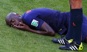 Bruno Martins Indi lies on the floor in pain.