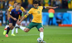 Mile Jedinak of Australia shoots and scores the penalty.