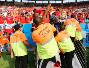 Stewards and Chilean supporters.