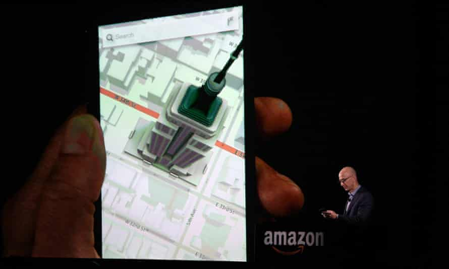 Amazon CEO Jeff Bezos shows off the 3D features of his company's new Fire smartphone at a news conference in Seattle