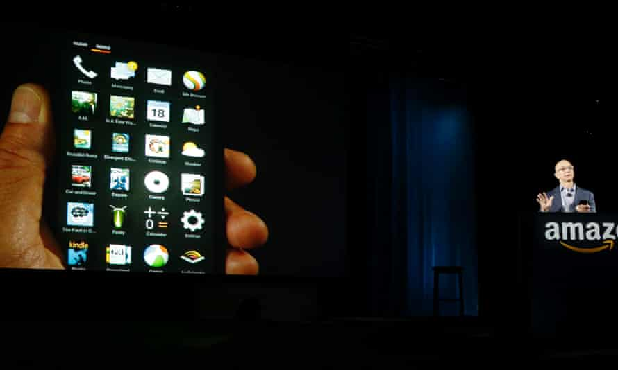 Amazon CEO Jeff Bezos shows off the app grid on the new Amazon Fire phone at a launch event in Seattle.