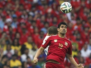 Chile's Francisco Silva and Spain's Diego Costa  vie for the ball.