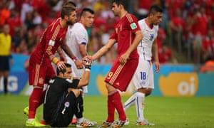 Diego Costa of Spain pulls up Chile goalkeeper Claudio Bravo
