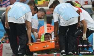 Chile's midfielder Charles Aranguiz is carried off on a stretcher.