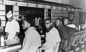 Four African American college students sit in protest at a whites-only lunch counter during the second day of peaceful protest at a Woolworth's in Greensboro, North Carolina.