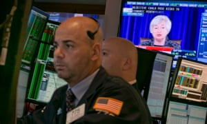 Federal Reserve Chair Janet Yellen's news conference appears on a television monitor on the floor of the New York Stock Exchange, Wednesday, June 18, 2014.