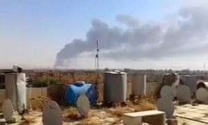 A large plume of smoke rises from what is said to be Baiji oil refinery in Baiji, northern Iraq.