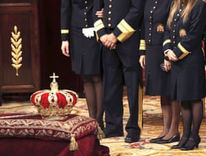 Ushers stand next to the crown inside the hemicycle  before the proclamation to the Parliament of Spain's new King Felipe VI at the Congress of Deputies.