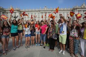 Wellwishers gather at the Royal Palace.