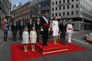 King Felipe VI, Queen Letizia, their daughters, Princess Leonor of Asturias, second left, and Princess Sofia, left,and Spanish Prime Minister Mariano Rajoy stand for the national anthem.