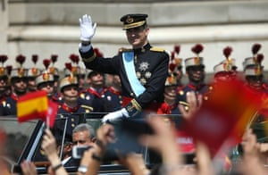 King Felipe VI greets crowds of wellwishers as he arrives at the Royal Palace.