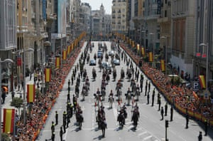 King Felipe VI and his wife Queen Letizia in a parade through the streets of Madrid from the Congress of Deputies to the Royal Palace.