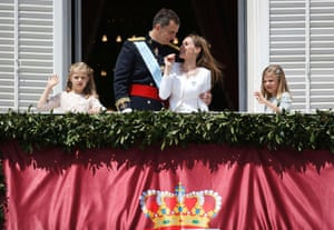 Spain's new King appears on the balcony of the Royal Palace with his family.