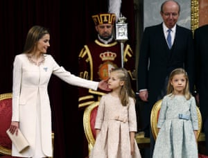 Spain's Queen Letizia reaches over to Princess Leonor of Asturias near Princess Sofia during the official proclamation at the Parliament's Lower House.