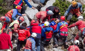 Rescuers carry injured cave researcher Johann Westhauser on a stretcher near the entrance to the Riesending cave