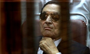 Hosni Mubarak at his retrial over charges of failing to stop the killing of protesters in 2011