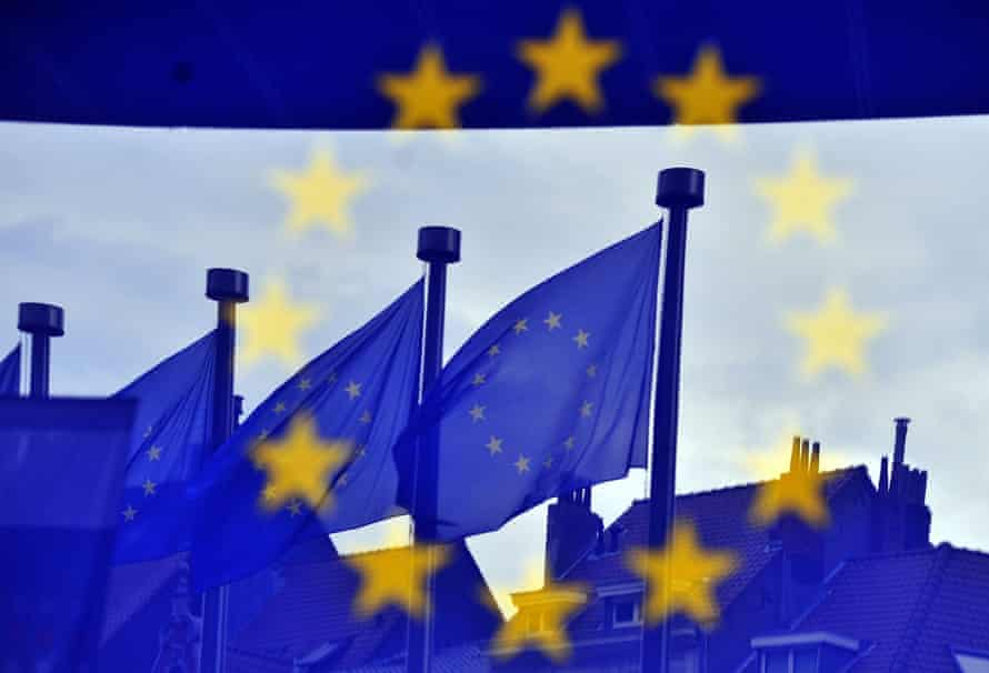 European flags at the entrance to the EU Commission headquarters in Brussels.