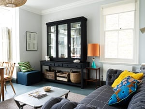 Homes - Keep it Simple: interior of lounge with grey sofa and cabinet