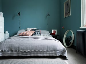 Homes - Keep it Simple: interior of bedroom with blue/green walls and grey floor