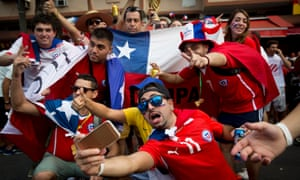 Chile fans enjoy themselves ahead of their World Cup Group B victory over Spain at the Maracanã.