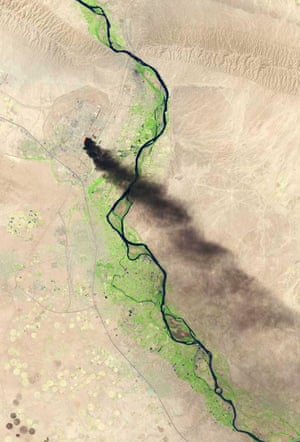 In this handout photo provided by the USGS, A satellite view shows smoke billowing from the Baiji North refinery complex on June 18, 2014 in Baiji, about 130 miles north of Baghdad.