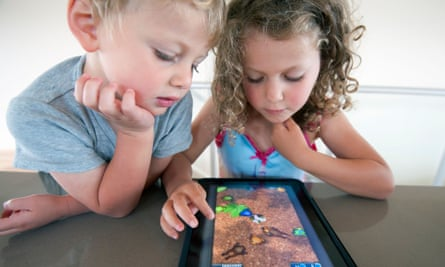 Children playing a tablet game