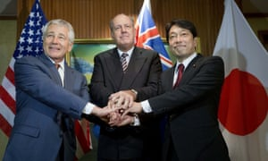 US Defense Secretary Chuck Hagel, (L) with Japanese Defense Minister Itsunori Onodera, (R) and Australian Defense Minister David Johnston