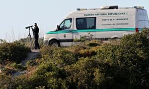 Portuguese police searching for Madeleine McCann at the Praia da Luz scrubland