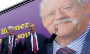 Nigel Farage, the Ukip leader, poses with Roger Helmer in front of a campaign poster for Helmer, the Ukip candidate in Newark.