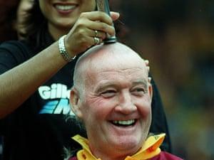 Rodney Marsh has his hair cut.