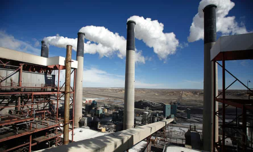 Steam rises from the stakes of the coal-fired Jim Bridger Power Plant supplied by the neighboring Jim Bridger mine