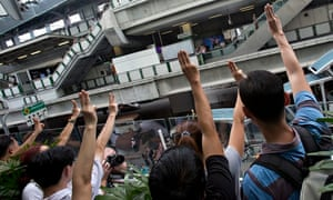 Protesters give the salute in Bangkok, Thailand.