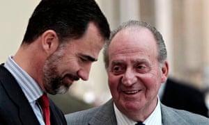 King Juan Carlos with his sone Crown Prince Felipe in Madrid in 2011