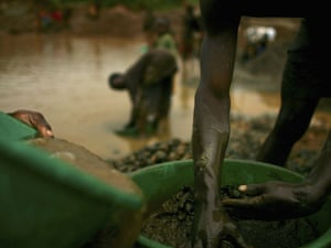 Sifting through buckets of dirt looking for gold in Mongbwalu, DRC
