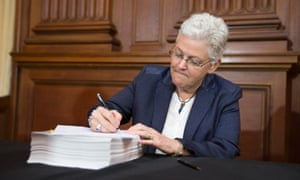 Environmental Protection Agency (EPA) Administrator Gina McCarthy signs new emission guidelines during an announcement of a plan to cut carbon dioxide emissions from power plants by 30 percent by 2030, Monday, June 2, 2014, at EPA headquarters in Washington.