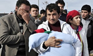 Migrants who survived the capsizing of their boat near the Greek island of Farmakonissi