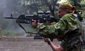 Pro-Russia militants fire from a residen