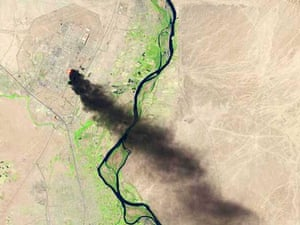 A satellite view shows smoke billowing from the Baiji North refinery complex on June 18, 2014 in Baiji, about 130 miles north of Baghdad.