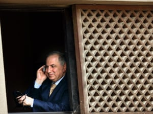 Former Pentagon favourite Ahmad Chalabi twirls his prayer beads whilst making a phone call in Baghdad.