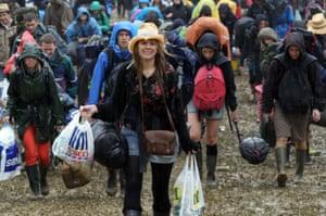 Mud and the rain at the Glastonbury Festival.