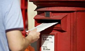 Man posting letter