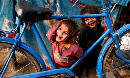 Street children play on a roadside in Allahabad, India.