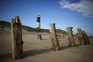 """The disused lighthouse. Spurn Point , a narrow sandpit jutting out into the North Sea from the north bank of the River Humber to the east of Hull, in the East Riding of Yorkshire.  AFter two hundred years living in the remote base, they have been moved onto the """"mainland"""". Tidal egosion and frequent washovers of sand and sea mean the narrow single track roadway is often under water and the base can be cut off for days at a time, which the RNLI deemed as unsustainable for family life in the 21st century."""