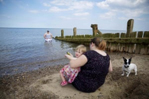 Jake Mars and his family cooling off , bathing on Hornsea beach.