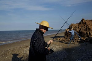 Jenny Major and Malcolm Haswell fishing at the foot of the cliffs at Aldbrough.